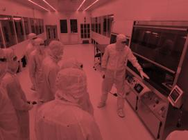 People looking at a cleanroom tool